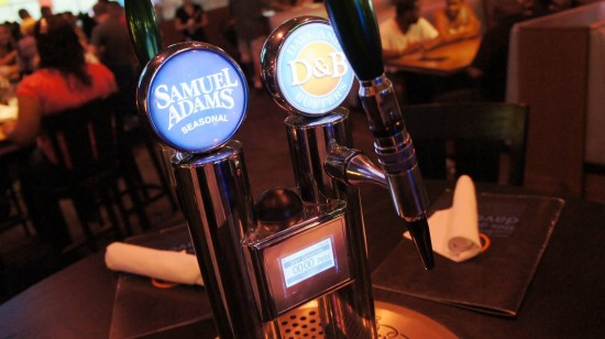 Dave & Busters Orlando on International Drive: Self-serve draft beer at the tables.