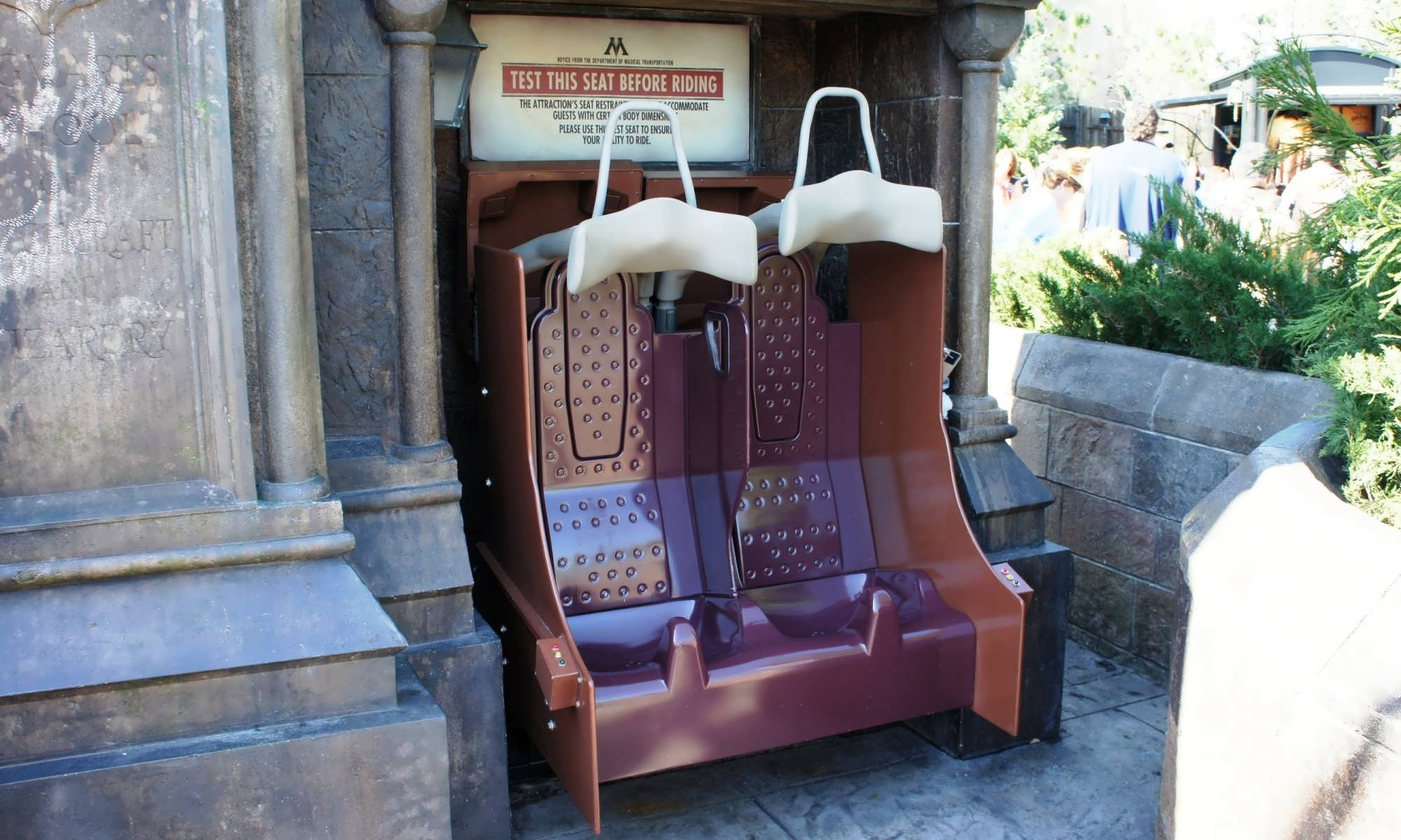 Forbidden Journey test seats located at the gates to Hogwarts Castle.