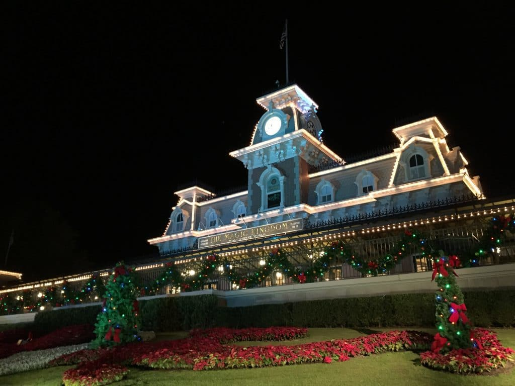 Front of Magic Kingdom train station. With red poinsettias, garland, and lights.