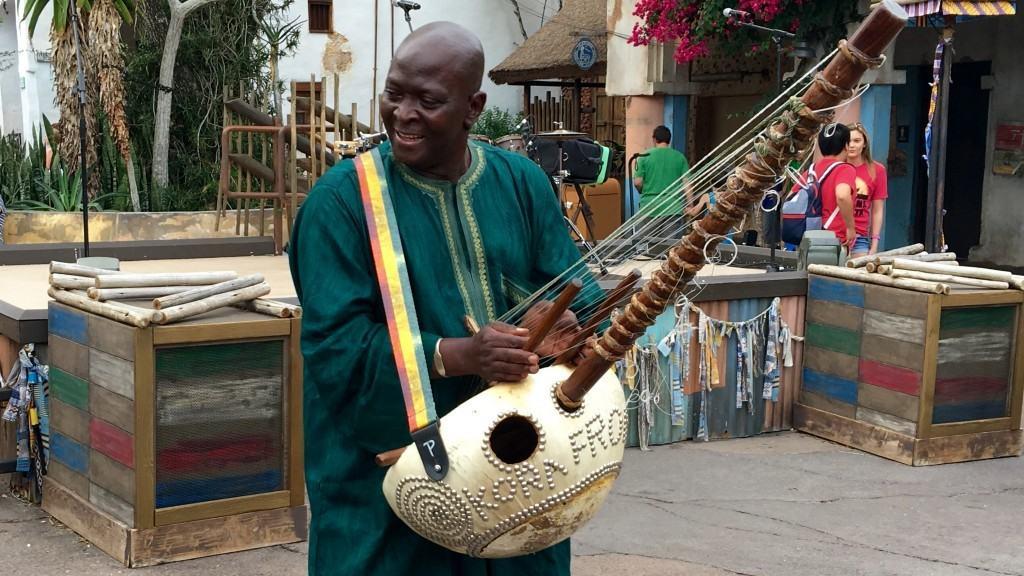 An artist playing the kora at the Harambe Wildlife Parti at Disney's Animal Kingdom