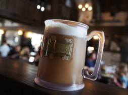 Butterbeer in a souvenir cup from the Wizarding World of Harry Potter at Universal Orlando Resort.
